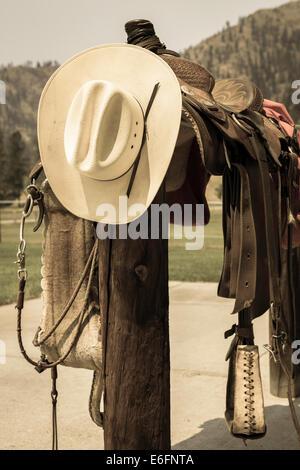 Tooled Leather Saddle on Hitching Post, Montana - Stock Photo