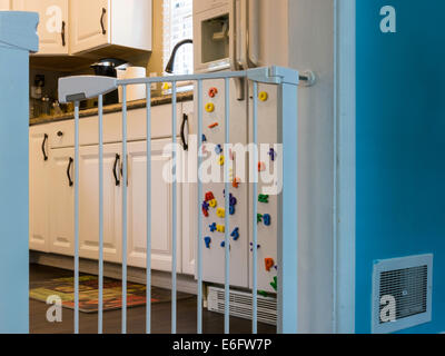 Baby Gate At Kitchen Doorway, USA   Stock Photo