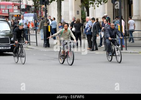 London, England, UK. Cyclists in Trafalgar Square - Stock Photo