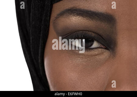 Beautiful black oriental colored woman face: eyes and beauty. - Stock Photo