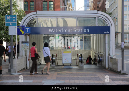 people enter Vancouver skytrain station - Stock Photo