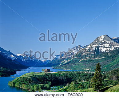 Prince of Wales Hotel overlooking Upper Waterton Lake in Waterton Lakes National Park in Alberta Canada - Stock Photo