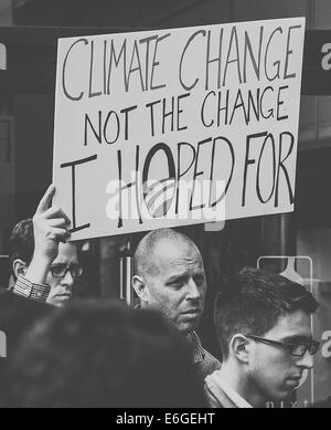 Environmentalist angry with Obama over climate change hold a catchy sign at a protest against the Keystone XL Pipeline - Stock Photo