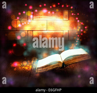 Old book with magic Ray of light - Stock Photo