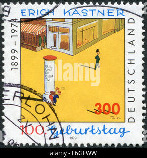 Stamp printed in Germany, 100th anniversary of the Erich Kastner, Illustration by Walter Trier to 'Emil and the - Stock Photo