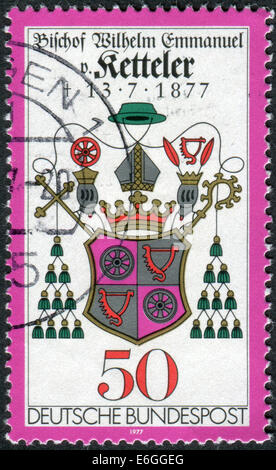 Stamp printed in Germany, 100th anniversary of the death of Wilhelm Emmanuel von Ketteler, Bishop Ketteler's Coat - Stock Photo