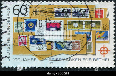 Postage stamp printed in Germany dedicated to the 100th anniversary of the postage stamp for Bethel - Stock Photo