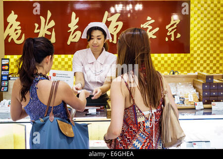 Hawaii Oahu Hawaiian Honolulu Ala Moana Center centre mall Minamoto Kitchoan sweets confections desserts Asian woman - Stock Photo