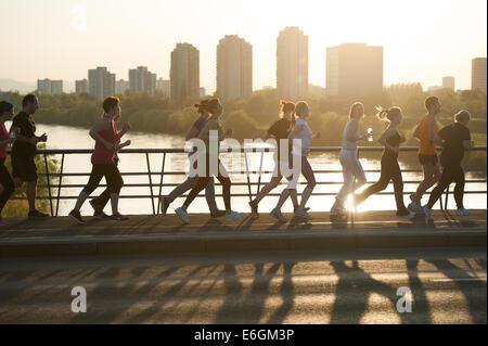 Running across the river Sava in Zagreb - Stock Photo