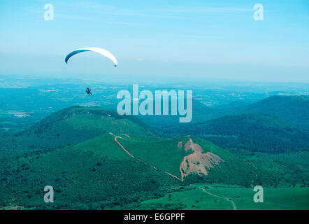Hangliding near the Puy de Dome volcano in Auvergne, France. - Stock Photo