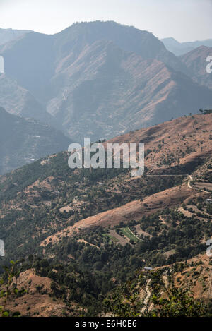 A mountain backdrop and farming country in the Himalayan foothills in Himachal Pradesh,India - Stock Photo