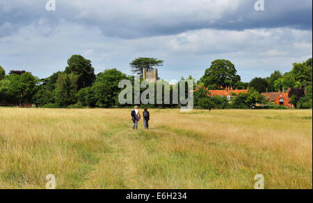 Lady Ramblers on an English Rural through a meadow with in the Chiltern village of Hambleden - Stock Photo