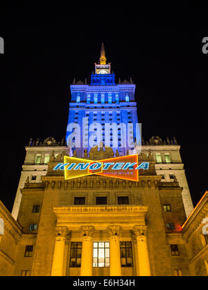 Warsaw, Poland. 22nd August, 2014.  Warsaw's Palace of Culture and Science bathed in the blue and yellow colours - Stock Photo