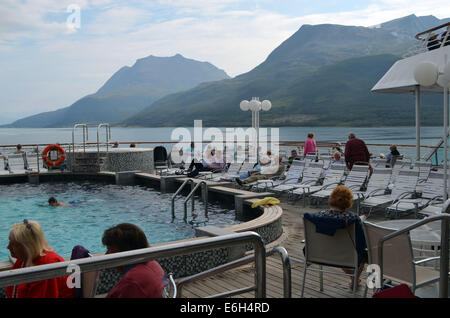 The swimming pool on board the SS Balmoral continues to entertain as the boat journeys through the fjords of Norway. - Stock Photo