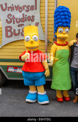 Bart Simpson television character giving 'thumbs up' sign with Marge Simpson at Universal Studios in Orlando Florida - Stock Photo