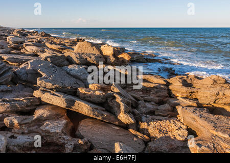 Coquina rock formations along coast of Atlantic Ocean at Washington Oaks Gardens State Park in Palm Coast, Florida, - Stock Photo