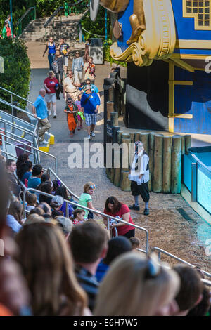 Mime keeps crowd entertained before the Clyde and Seamore animal sea lion show at Sea World in Orlando, Florida - Stock Photo