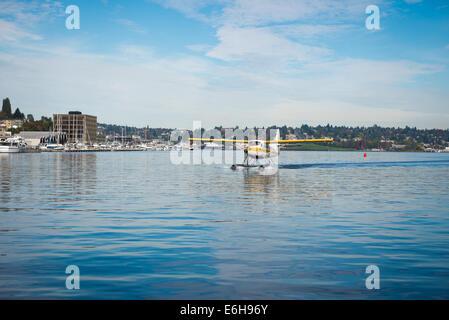Seaplane landing on Lake Union, Seattle - Stock Photo