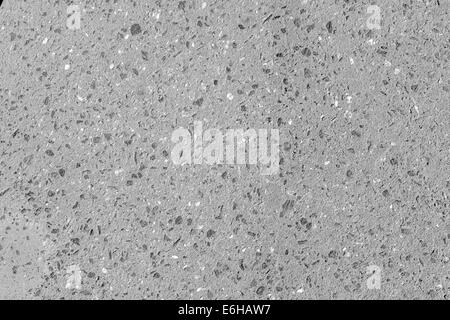 Close up of exposed aggregate concrete wall panel with uncolored concrete - Stock Photo