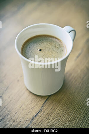 Freshly brewed coffee cup on tabletop. - Stock Photo