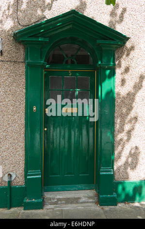 Green number 5 wooden front door of period terraced house in Brecon Powys Wales UK - Stock Photo