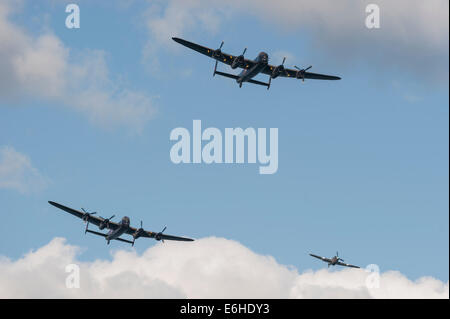 Battle of Britain Memorial Flight with Avro Lancasters City of Lincoln PA474 'Thumper' and the Canadian Warplane - Stock Photo