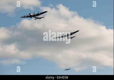 Dawlish, UK. 23rd Aug, 2014. Battle of Britain Memorial Flight with Avro Lancasters PA474 'Thumper' and the Canadian - Stock Photo
