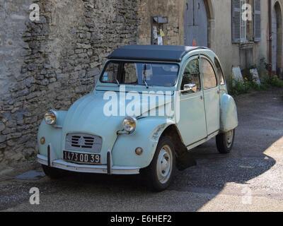 Light blue vintage Citroen 2CV car parked in a village in France - Stock Photo