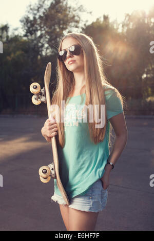 Teen model posing in sunglasses - Stock Photo