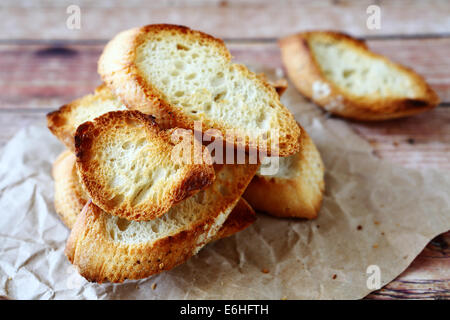 baguette slices dried in the oven, food closeup - Stock Photo