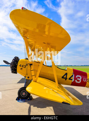 Wide-angle view of a Boeing Stearman E75 Kaydet (N2S-5) biplane, taken from the port wing-tip - Stock Photo