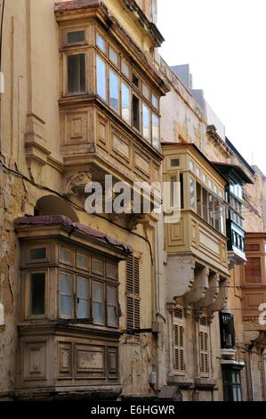 a row of majestic old buildings in the centre of Valletta, Malta, a Unesco world heritage site, with Ottoman style - Stock Photo