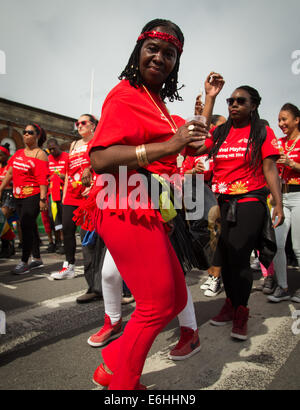 London, UK. 24th Aug, 2014. A lady in red shakes her stuff at the  2014 Notting Hill Carnival Credit:  On Sight - Stock Photo