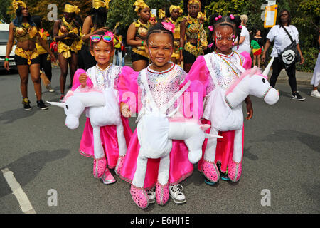 London, UK. 24th August 2014. Participants in the parade on Children's Day at Notting Hill Carnival 2014, London. - Stock Photo