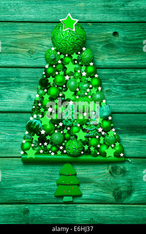 Christmas decoration in green: tree of different balls on wood - country style. - Stock Photo
