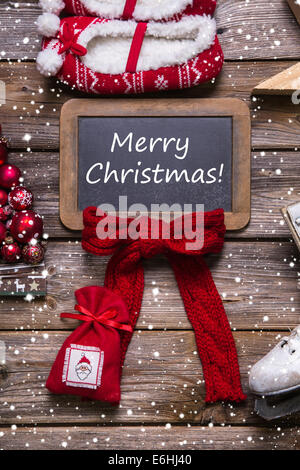 Merry christmas greeting card in classic style: red, white, wood in country style. - Stock Photo