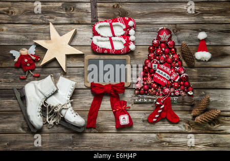 Classic christmas decoration in red and white with wood on background. - Stock Photo