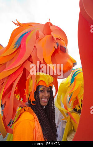 London, UK. 24 August 2014. Pictured: members of the Mahogany carnival group. Notting Hill Carnival 2014 gets underway - Stock Photo