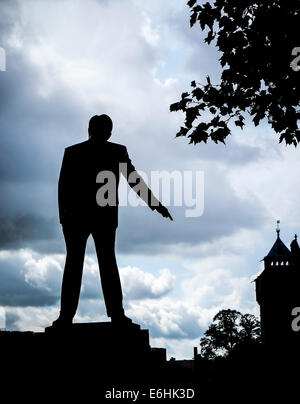 The silhouette of the statue of Aneurin Bevan in Cardiff City centre. - Stock Photo