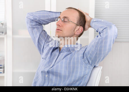 Businessman relaxing in the office at meantime. Work life balance concept. - Stock Photo