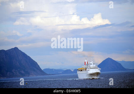 The boat continues down the Norwegian coast, steadily making its way south,past the small islands. - Stock Photo