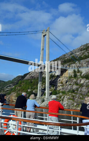 The boat continues down the Norwegian coast, steadily making its way south,past the small islands.Past a bridge - Stock Photo