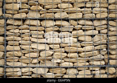 Close up of a stone Gabion basket wall. - Stock Photo