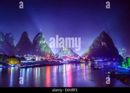 Yangshuo, China cityscape and karst mountains on the Li River. - Stock Photo