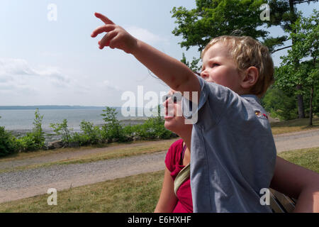 A two year old pointing something out to his mum, with the St Lawrence river at Quebec beyond - Stock Photo