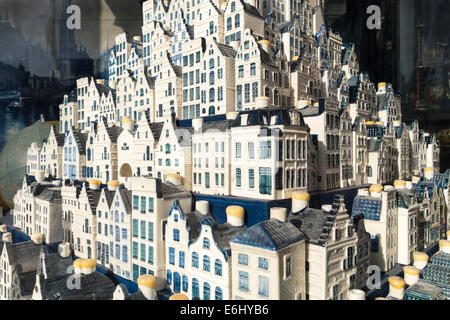 Amsterdam a display of delftware miniature Dutch canal houses in an antique shop. KLM airline souvenirs that contain gin