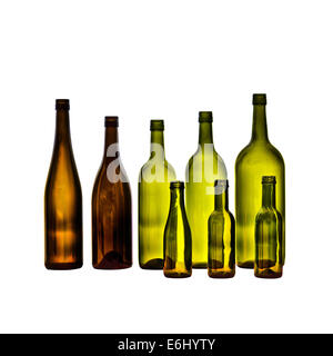 Empty glass wine bottles on white background. Bottles in various shapes and sizes. - Stock Photo