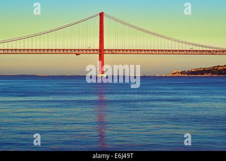Portufal, Lisbon: Scenic evening view of the red bridge Ponte 25 de Abril - Stock Photo