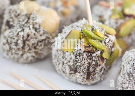 Special Turkish Fig Dessert topped with coconut powder, nuts and pistachio.