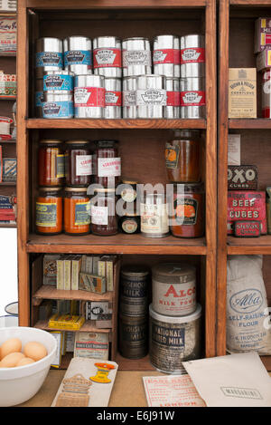 1940s replica grocers shop with packets of food and household items on the shelves at a historical military Reenactment - Stock Photo